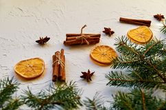 New year food decorations with fir branches and traditional spices for mulled wine – anise stars, cinnamon sticks, dried oranges royalty free stock photo
