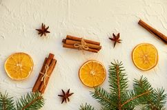 New year food decorations with fir branches and traditional spices for mulled wine – anise stars, cinnamon sticks, dried oranges royalty free stock photos