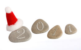 New Year: four stones with Santa's hat royalty free stock photography