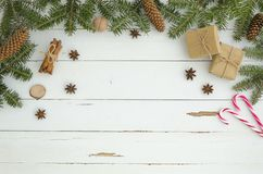 New year frame Christmas decoration on white wooden plank background. Flat lay, top view. Fir tree,pine conecinnamon. Anise star, gift box. Trendy Xmas To do stock image