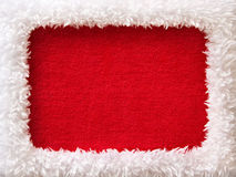New Year frame with red empty space. White fur New Year frame with red empty space (looks like a Santa outfit royalty free stock photos
