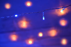 New Year garland on blue background with lights Royalty Free Stock Photos