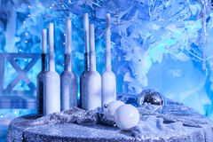 New Year, gift bottles with candles and Christmas balls royalty free stock photography