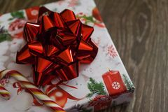 Gift with red bow and candy royalty free stock images