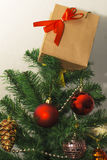 New Year gift on the Christmas tree. Closeup Royalty Free Stock Image