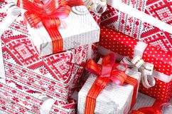 New Year gifts. A lot of red boxes with gifts for the new year. The traditional preparation of gifts under the Christmas tree in. New Year`s Eve stock image