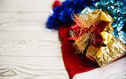 New year gifts and Santa hat Royalty Free Stock Images