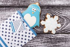 New Year gingerbread in a gift bag. Penguin and snowflake in the package. A gift to a child for Christmas stock image