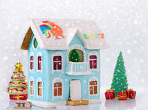 New year gingerbread two story house with balcony homemade and bokeh, snow Royalty Free Stock Images