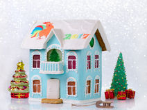 New year gingerbread two story house with balcony homemade and bokeh Stock Photos
