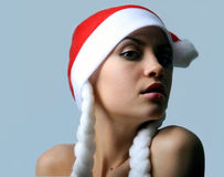 New year. Girl. The beautiful girl in a cap. A celebratory card stock image