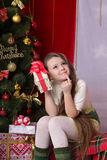 New year. Girl with gifts under the Christmas tree Royalty Free Stock Images