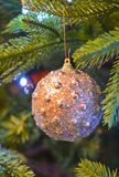 New Year gold ball. New Year  toy on the new year tree Royalty Free Stock Image