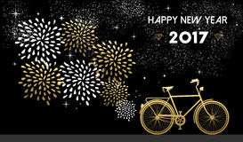New Year 2017 gold bike celebration background. Happy New Year 2017, gold card design with bike and fireworks in night sky background. EPS10 vector Stock Photo