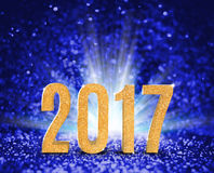 2017 new year with gold glitter texture with white explore light. On blue sparkling background,Holiday Concept (3d rendering Royalty Free Illustration