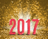 2017 new year with gold glitter texture with white explore light. On golden sparkling background,Holiday Concept 3d rendering Vector Illustration