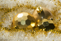 New Year gold tinsel and balls Stock Photos