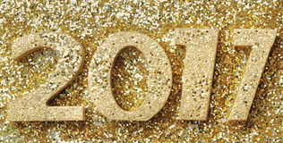 2017 new year. 2017 golden figures on golden glitters background Royalty Free Stock Photos