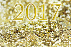 New year 2017 on golden glitters. 2017 written on golden and bright glitters background Stock Photography