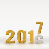 2017 new year golden sparkling glitter number change from 2016 y Stock Photo