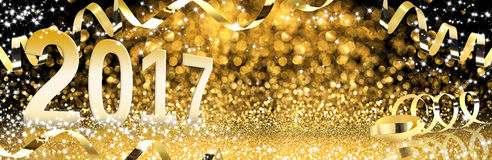 New Year, Golden Streamers With Sparkling Glitter. Party Stock Photos