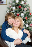 In the New year grandson hugging grandmother. Stock Image
