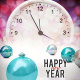 Composite image of new year graphic. New year graphic against glowing christmas background royalty free stock photography