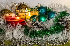 New year, green balls and decorations for the Christmas tree. Bright and beautiful scenery on a lemon background with white tinsel. And beads. Christmas winter stock image