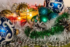 New year, green balls and decorations for the Christmas tree. Bright and beautiful scenery on a lemon background with white tinsel. And beads. Christmas winter royalty free stock photo