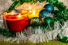 New year, green balls and decorations for the Christmas tree. Bright and beautiful scenery on a lemon background with white tinsel. And beads. Christmas winter stock images