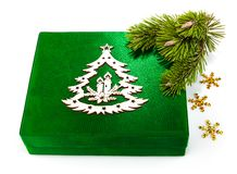 New Year green box with twig Christmas tree. Isolated on white background Stock Image