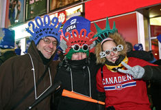New Year Greeted at Times Square. This was shot in New York on Dec. 31, 2008 and Jan. 1, 2009. The three are waiting for the arrival of the new year and the Royalty Free Stock Photo