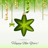 New Year greeting card. Christmas Star Ball with bow and ribbon. Xmas Decorations. Sparkles and bokeh. Shiny and glowing. Stock Images