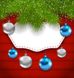 New Year greeting card with colorful balls and fir branches Royalty Free Stock Photos
