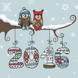 New year greeting card.Doodle Owl,knitted numbers. Christmas,New year doodle greeting card.Cartoon owl couple on branch. Knitted figures 2016 hanging on the Stock Photography