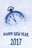 2017 New Year greeting card  in English language, pocket watch in snow Stock Images