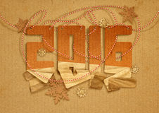 New Year greeting card. 2016 Happy New Year greeting card with paper snowflakes on cardboard background Royalty Free Stock Images