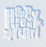 New Year greeting card. Happy New Year greeting card. Snow inscription on natural snow surface Stock Photos