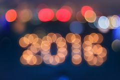 New year greeting card made of bokeh digits in shape of 2016 Royalty Free Stock Photography