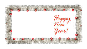 New year greeting card made of silver tinsel frame with red christmas balls Stock Images