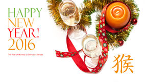 New year greeting card made of two glasses of champagne, yellow and green tinsel with red christmas balls, red ribbon with snowfla. Kes and orange candle with Royalty Free Stock Images