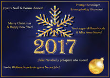 New Year Greeting card 2017 in many languages. Text translation: 'Merry Christmas and Happy New Year' in French, English, Dutch, Italian, Spanish and German Stock Images