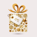 New Year  greeting card template. Gift box with 3d gold stars, snowflakes, bow ribbon and tag. Royalty Free Stock Photo