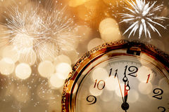 New Year greeting card with vintage clock and holiday lights Stock Image