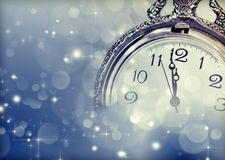 New Year greeting card with vintage clock and holiday lights Royalty Free Stock Photos