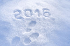 New Year 2016 greeting, foot step prints in snow, Stock Photos