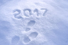 New Year 2017 greeting, footprints in snow, new year 2017, 2017 greeting card Stock Photo