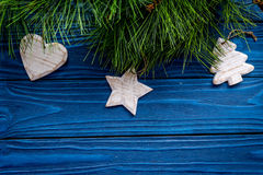 New year 2018 greeting with spruce branches and decorations with toys on blue wooden background top veiw space for text Royalty Free Stock Photography