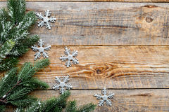 New year 2018 greeting with spruce branches and snowflake decorations on wooden background top veiw space for text Royalty Free Stock Photo