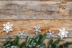 New year 2018 greeting with spruce branches and snowflake decorations on wooden background top veiw space for text Stock Image